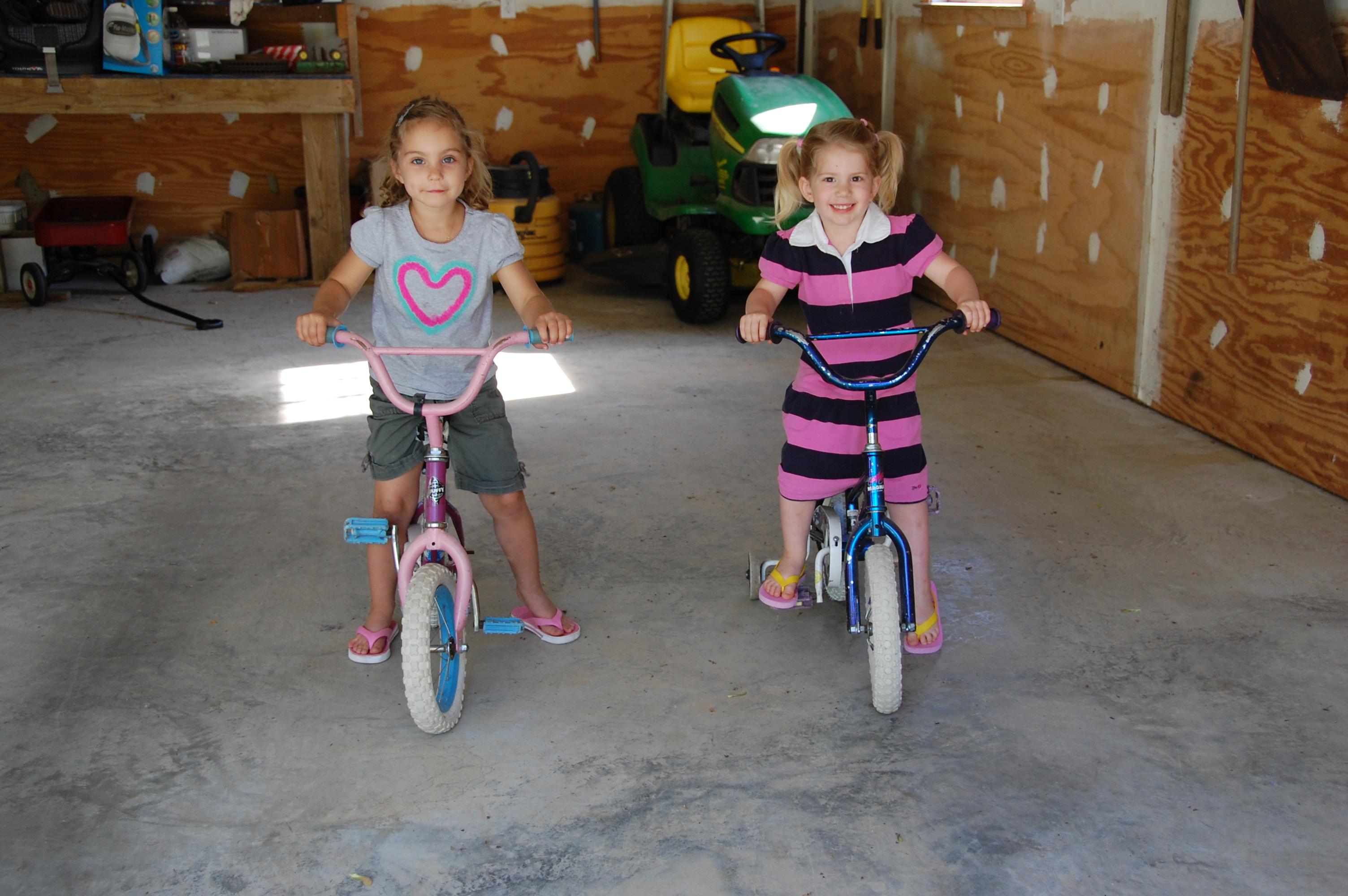 Brynn & Kaylin having fun riding bikes together