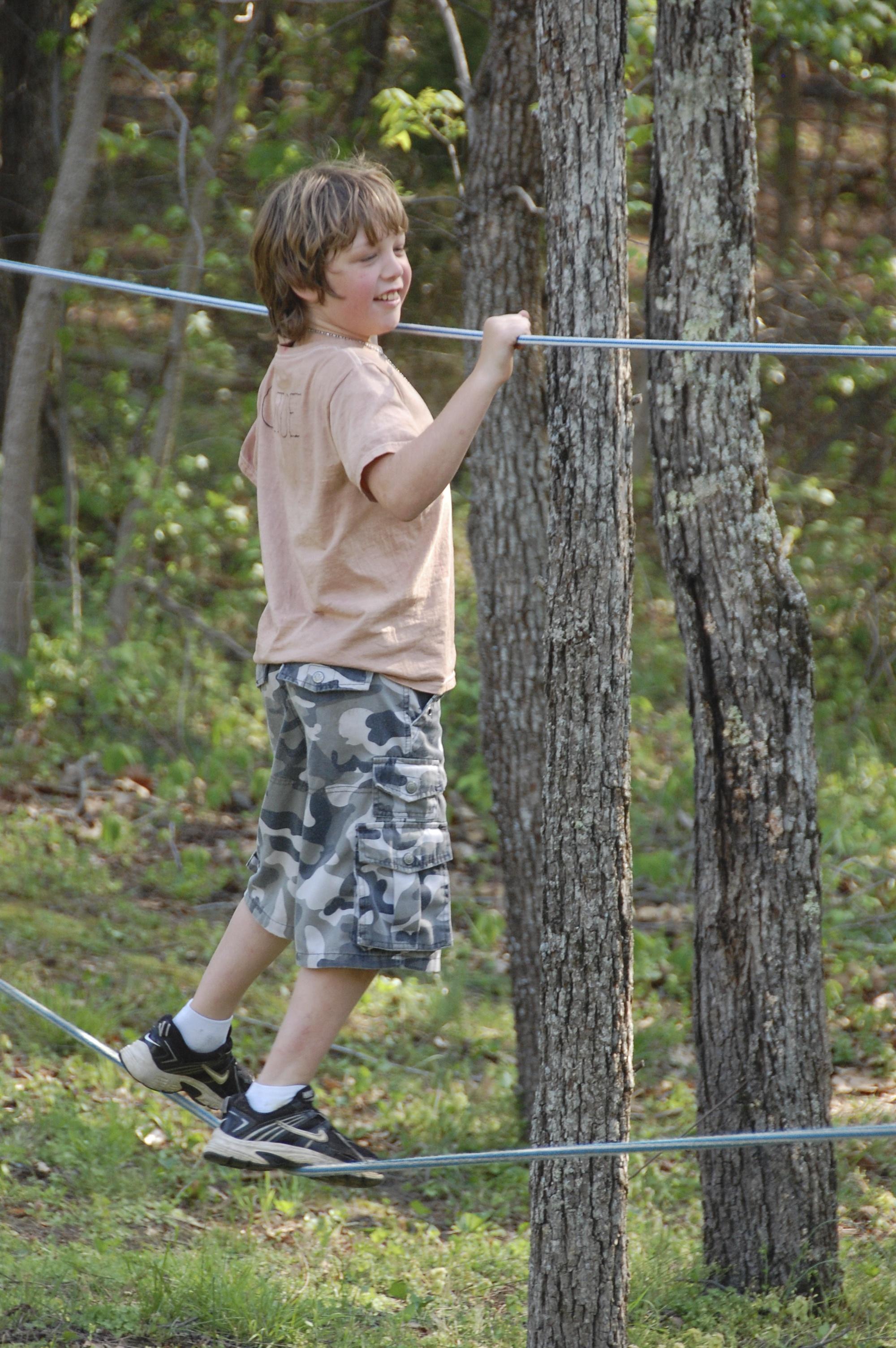 Birthday boy Burke crossing the ropes