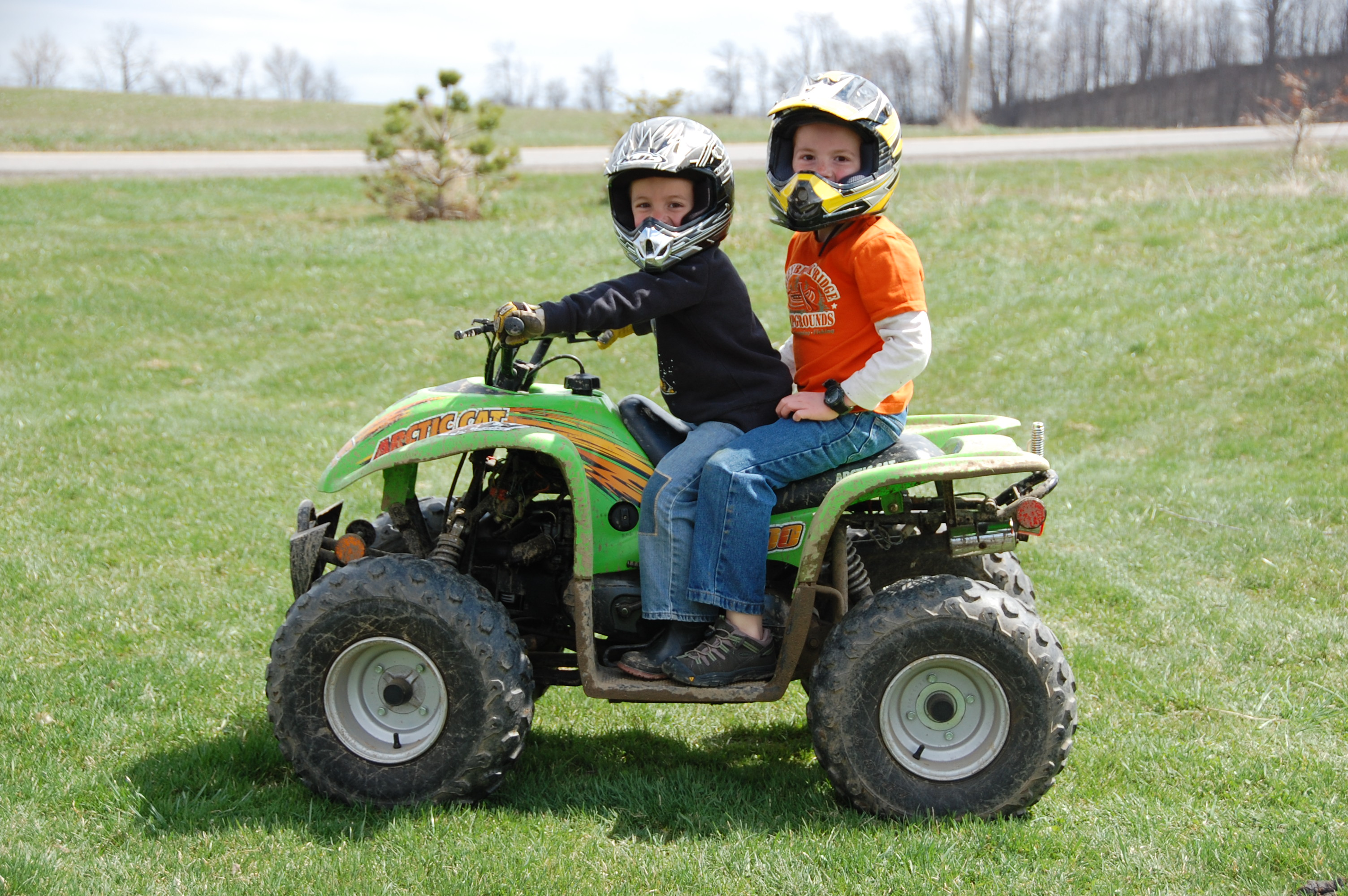 Bryant giving Cooper a ride on the 4-Wheeler.