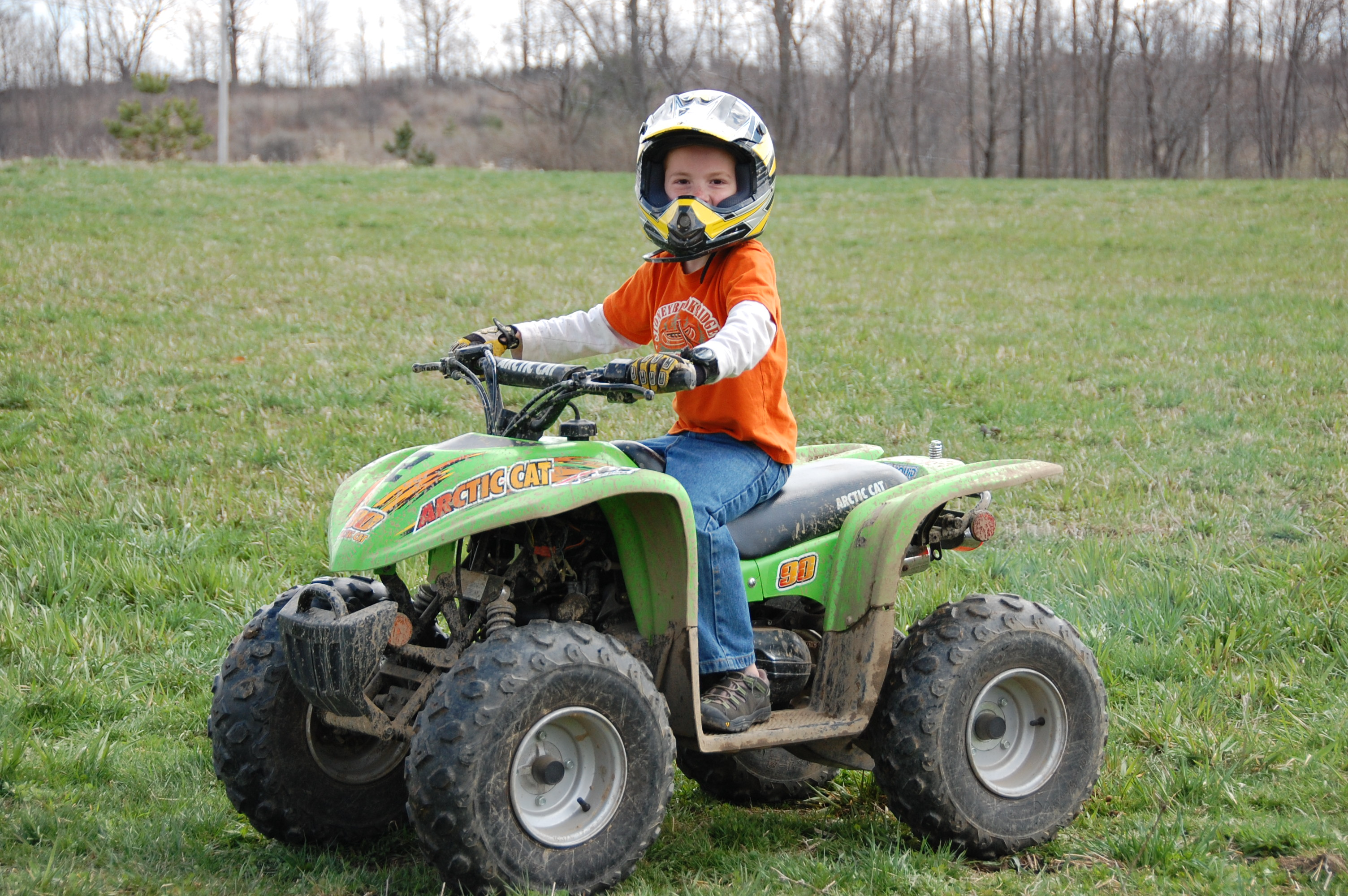 Cooper's turn to take the 4-wheeler for a spin.