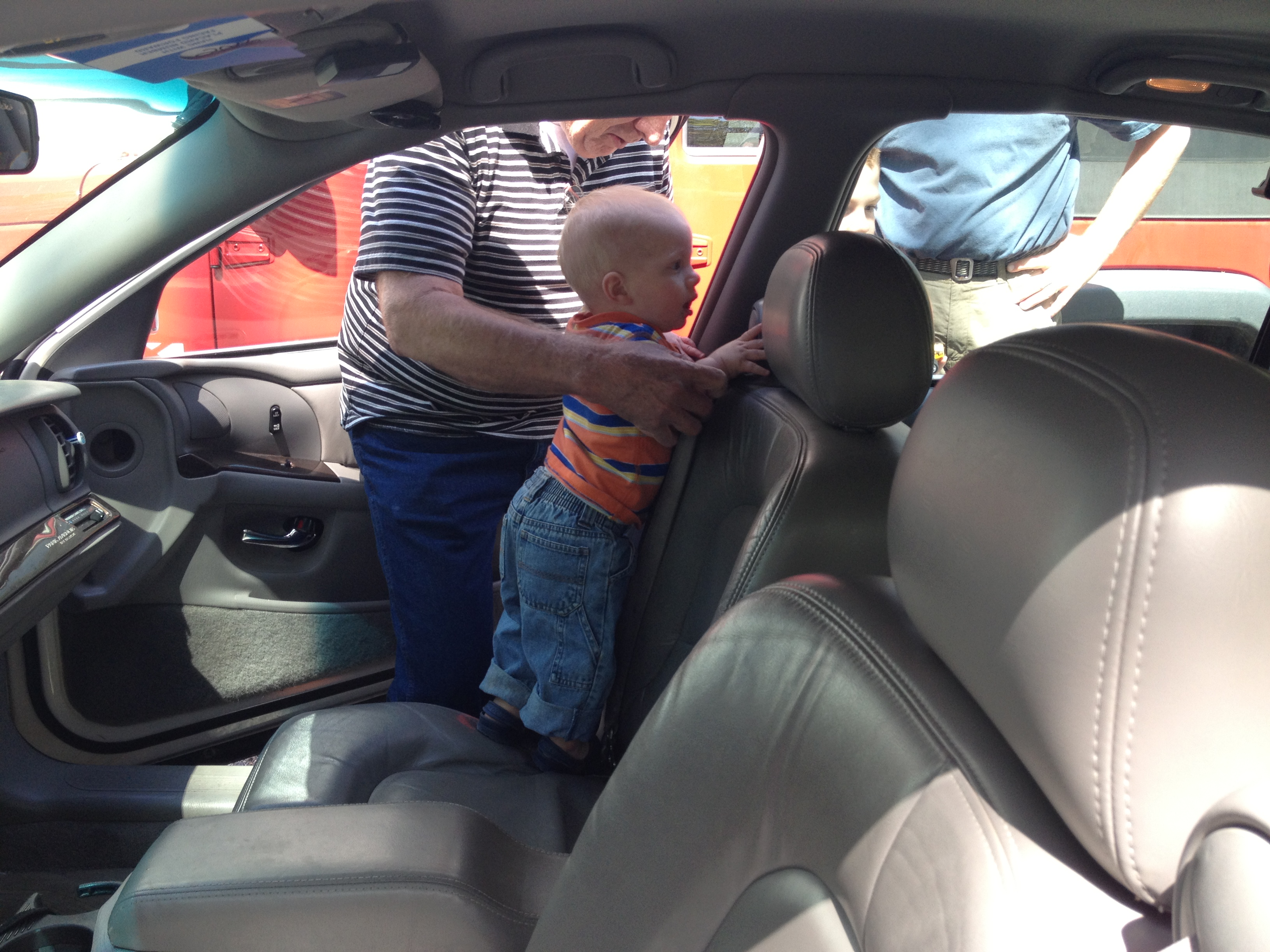Kolby climbed into Grandpa and Grandma's car as they were loading up. He loved Gidget and was trying to pet him.
