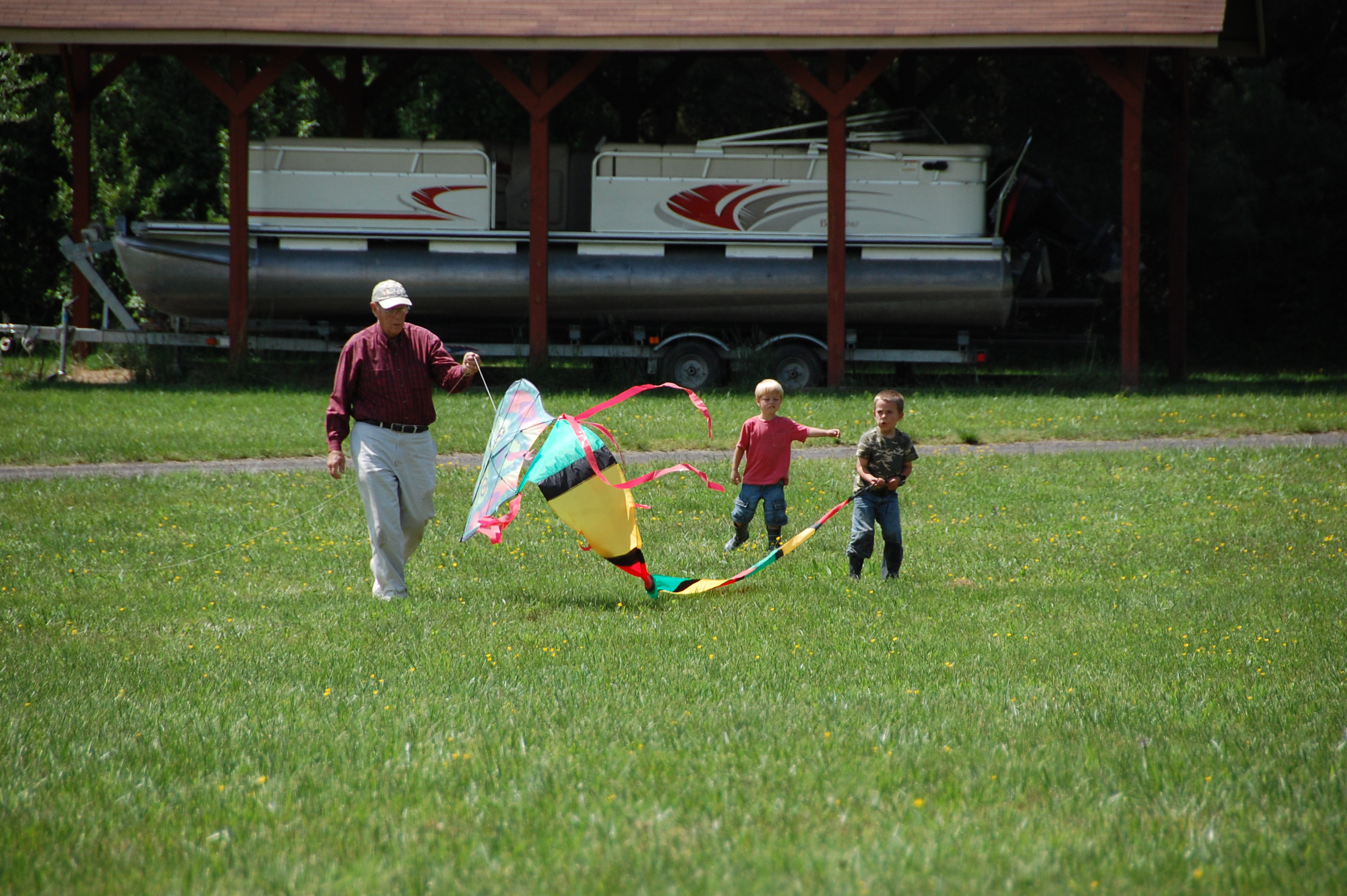 Granddaddy Cotten trying to fly a kite with Layton Cox & Bryant.