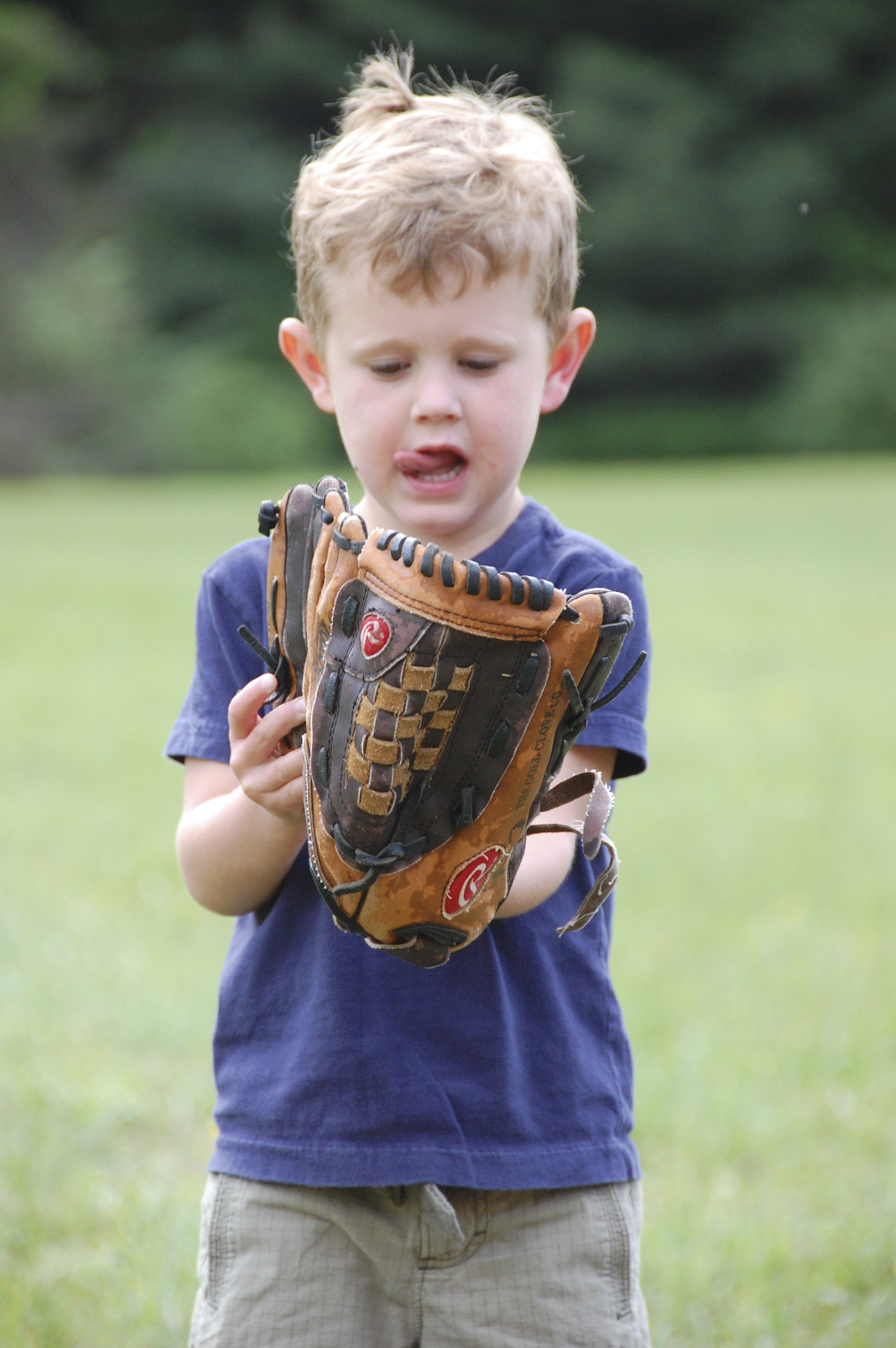 Braxton Kennedy working so hard to get that glove on! (Nick & Lindsey's oldest)