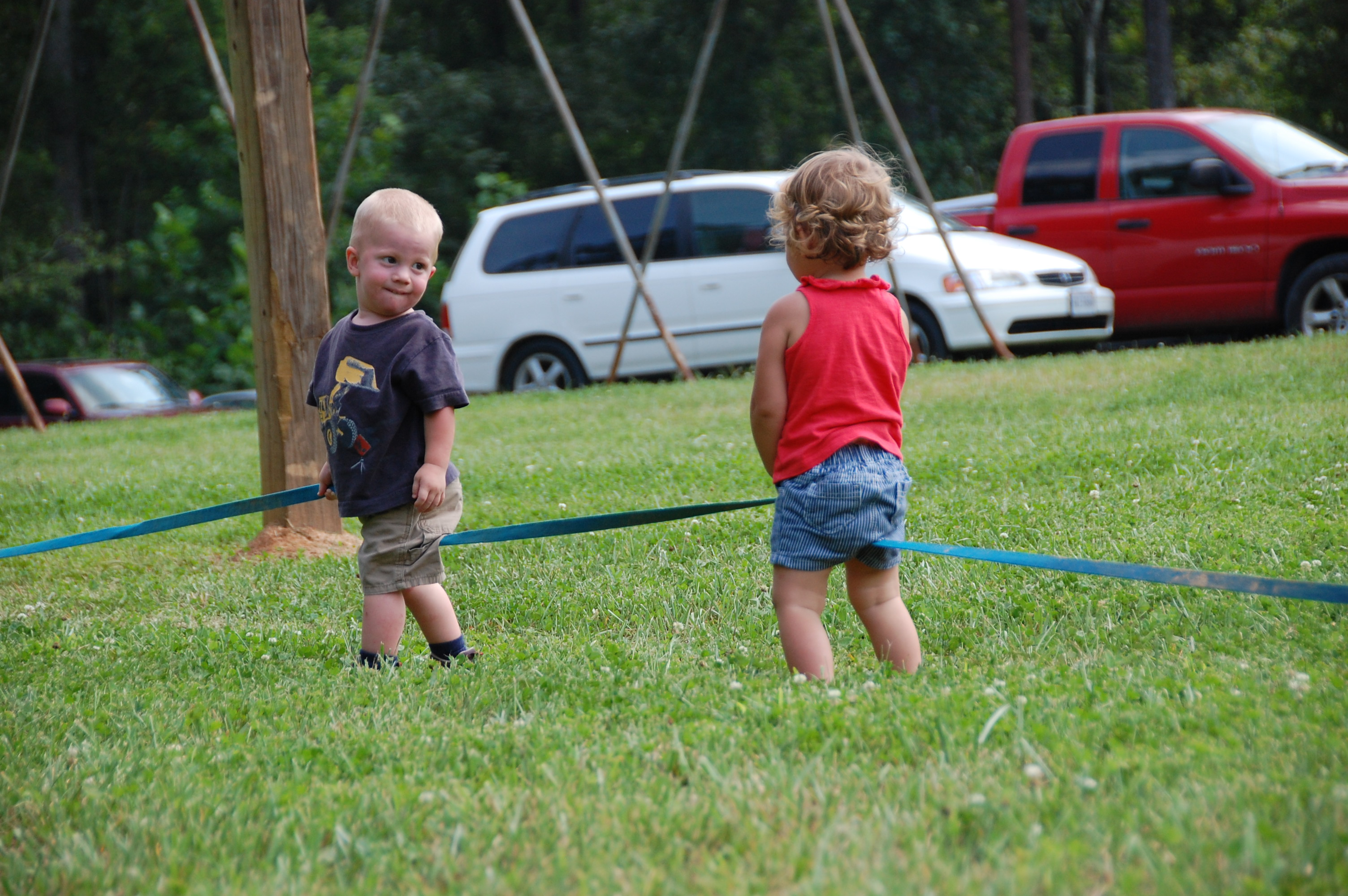 Kolby and Gemma Corle playing with the volleyball lines