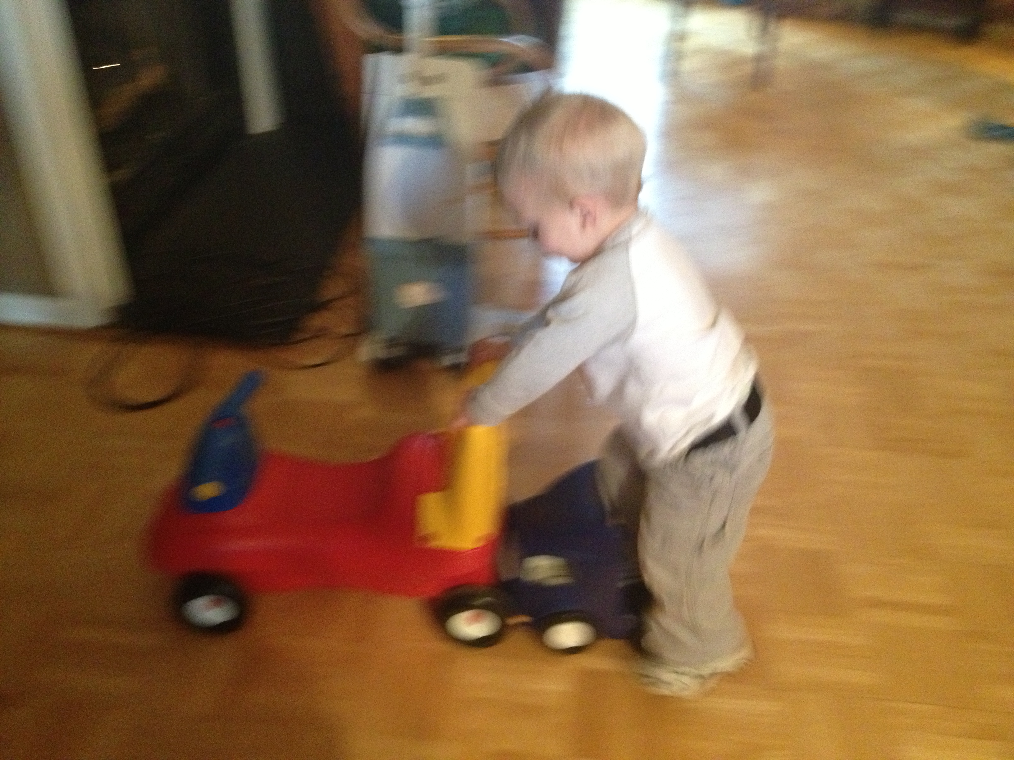 He was trying to keep up with the ride on in front. Sometimes he tries to ride the trucks like rollerskates.