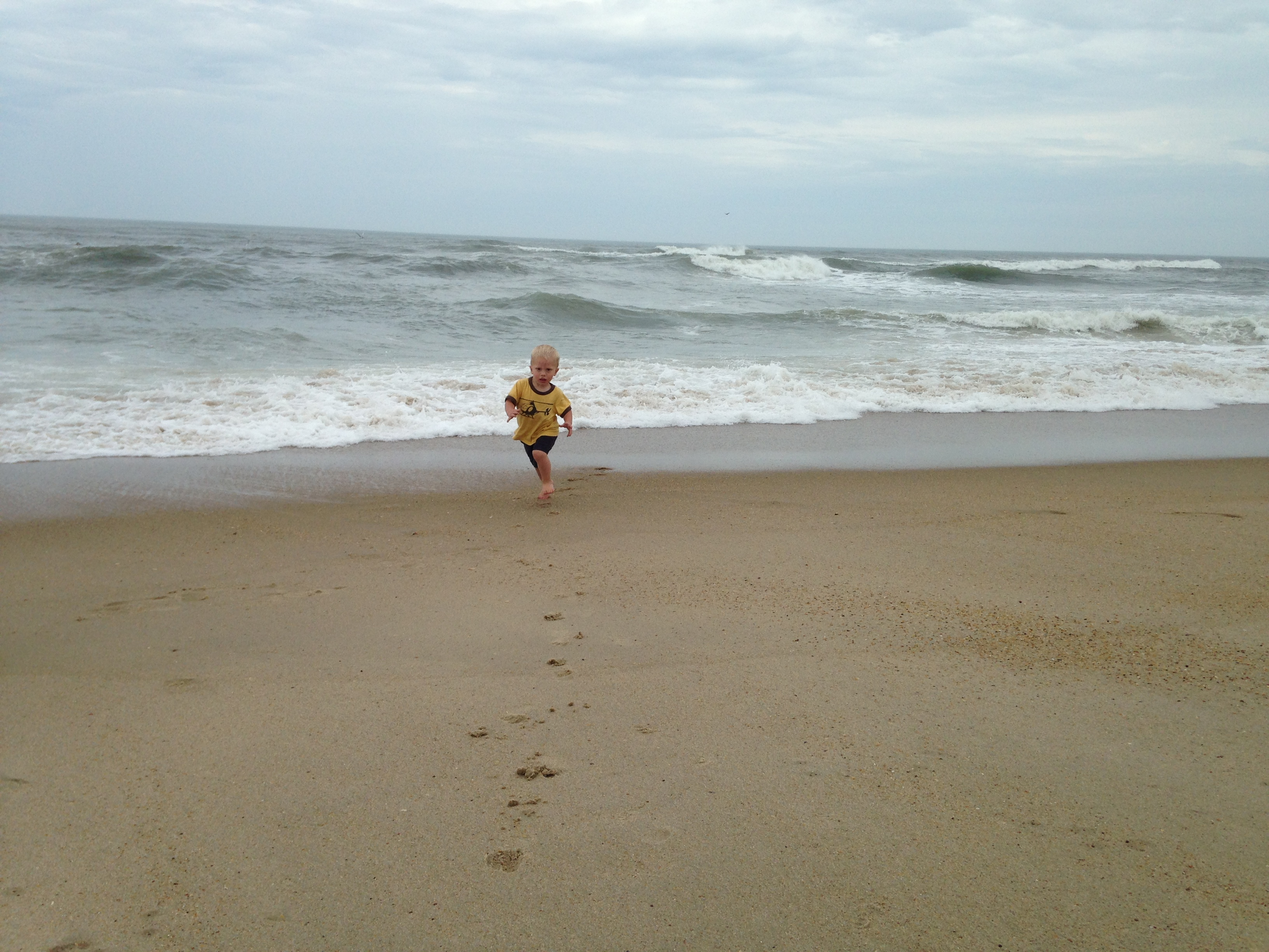 Kolby running from the waves