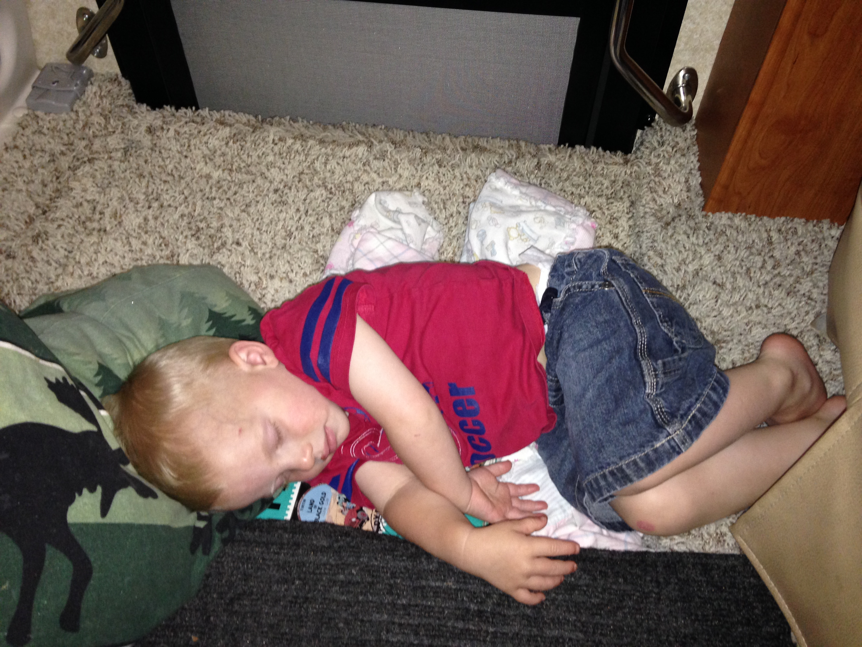 """Kolby found his little """"spot"""". He would bring his pillow, blanket, and backpack up to want the floor closed over the stairs and then he would play or take a nap. He had his own little spot close to Dad and Mom so he was all set!"""
