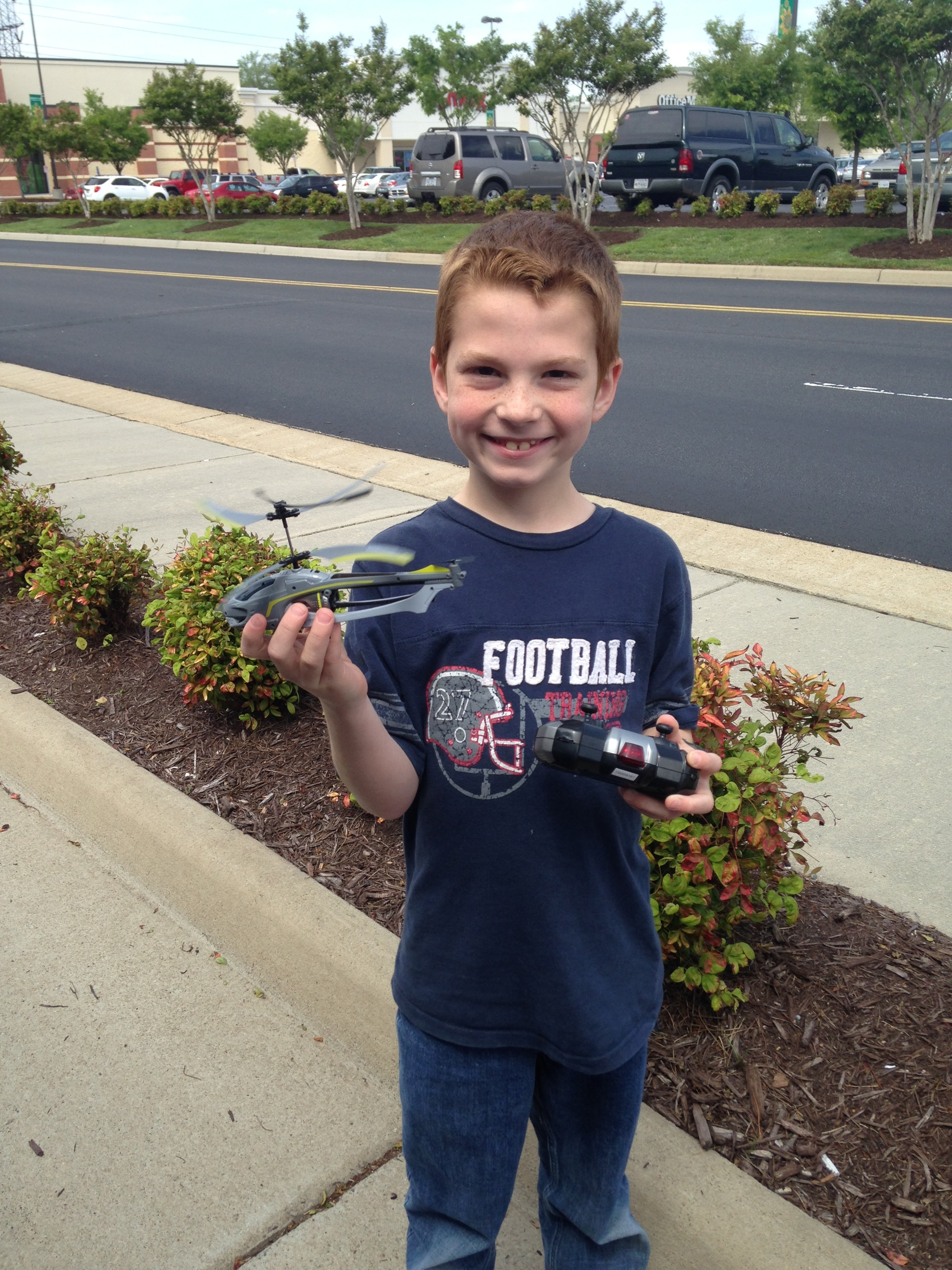 Cooper with his new remote control helicopter.