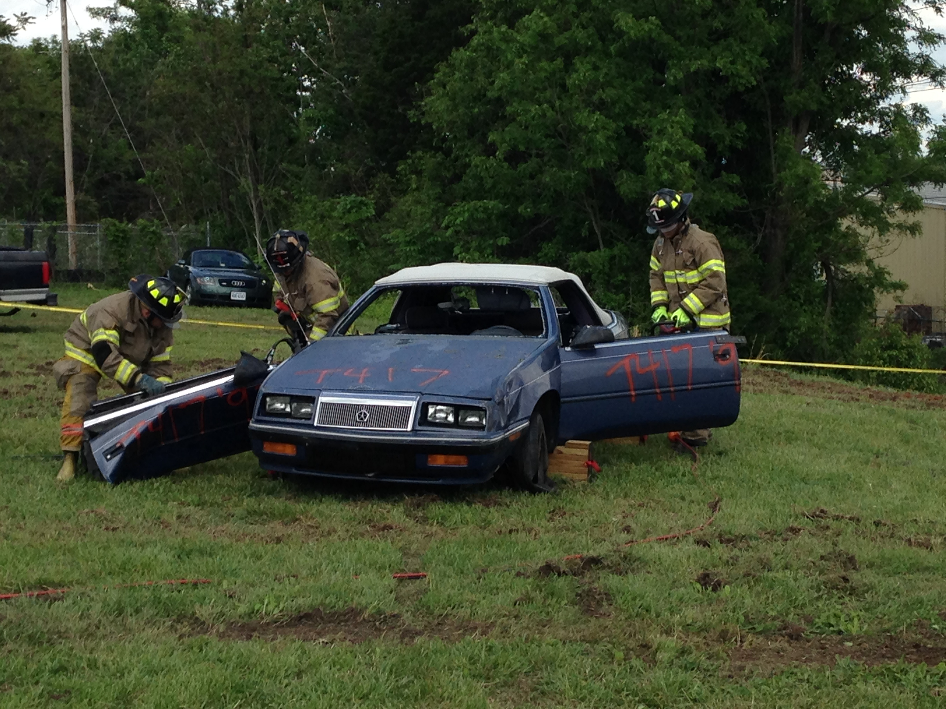 Using the Jaws of Life to remove the doors and top of the car.