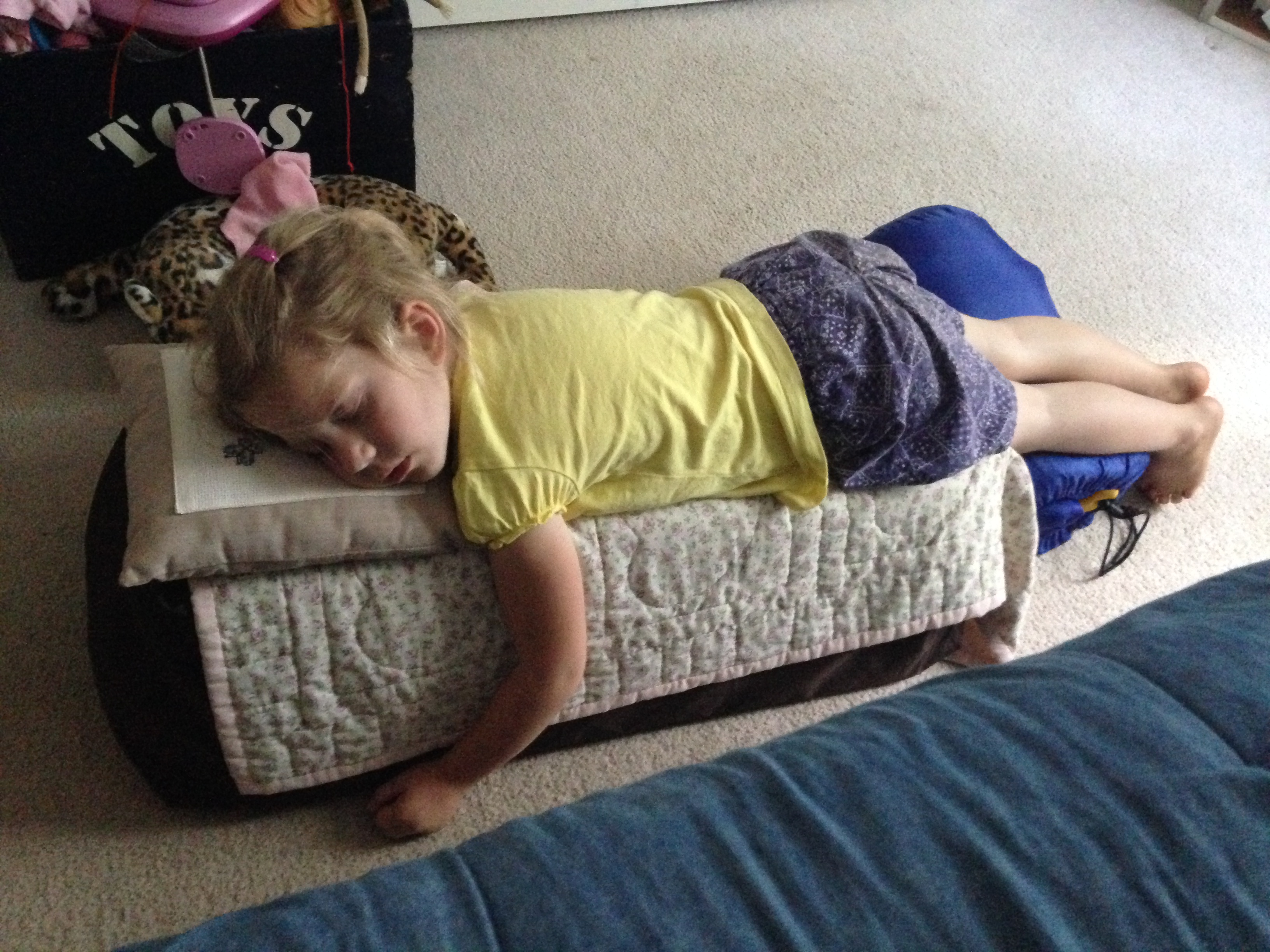 """Taking a nap before we went to camp. She picked the most """"comfy"""" place-on top of the pack n play and sleeping bag I had set out for Jimmy and Stephanie."""