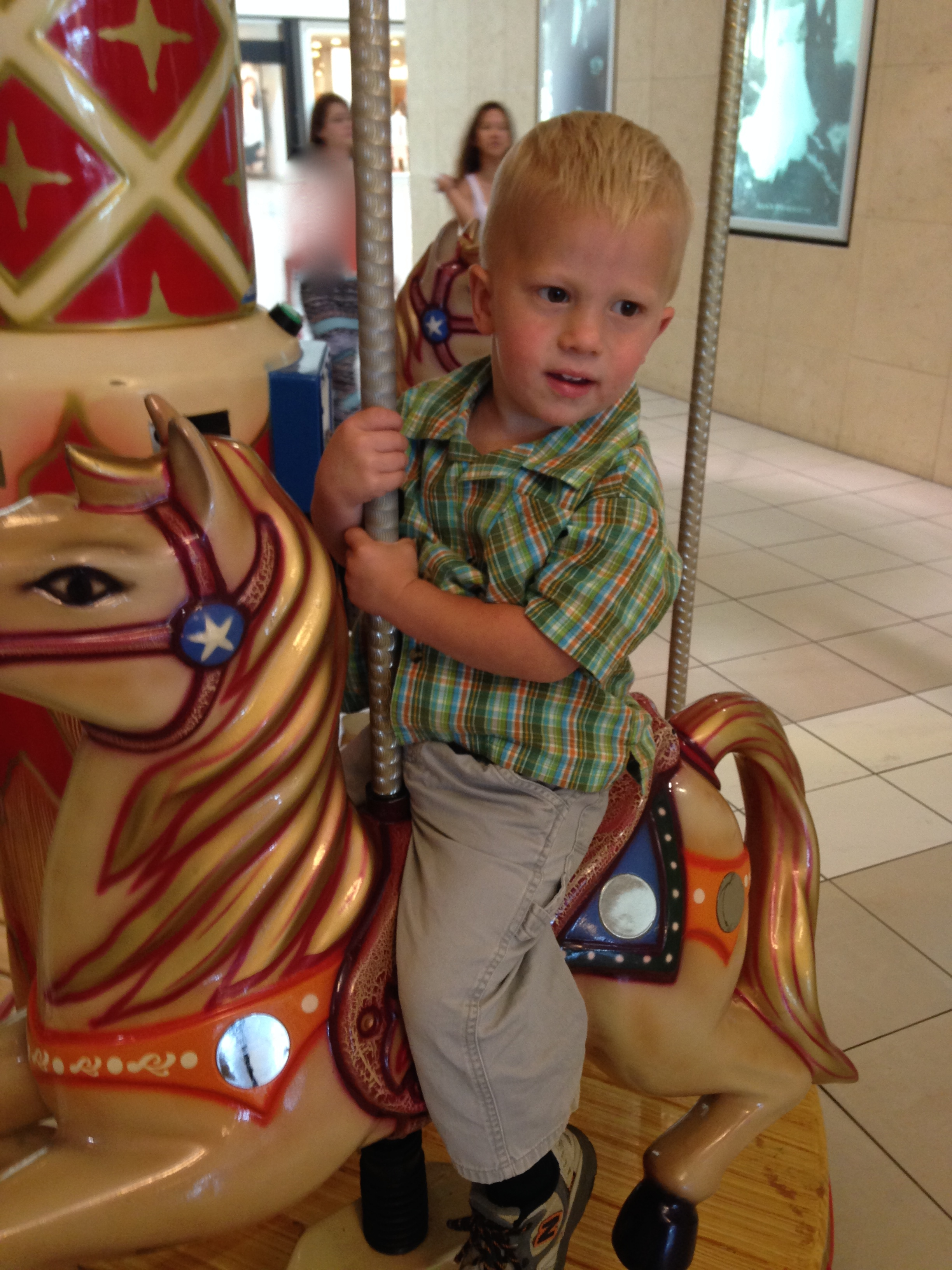 Kolby got to ride the carousel.