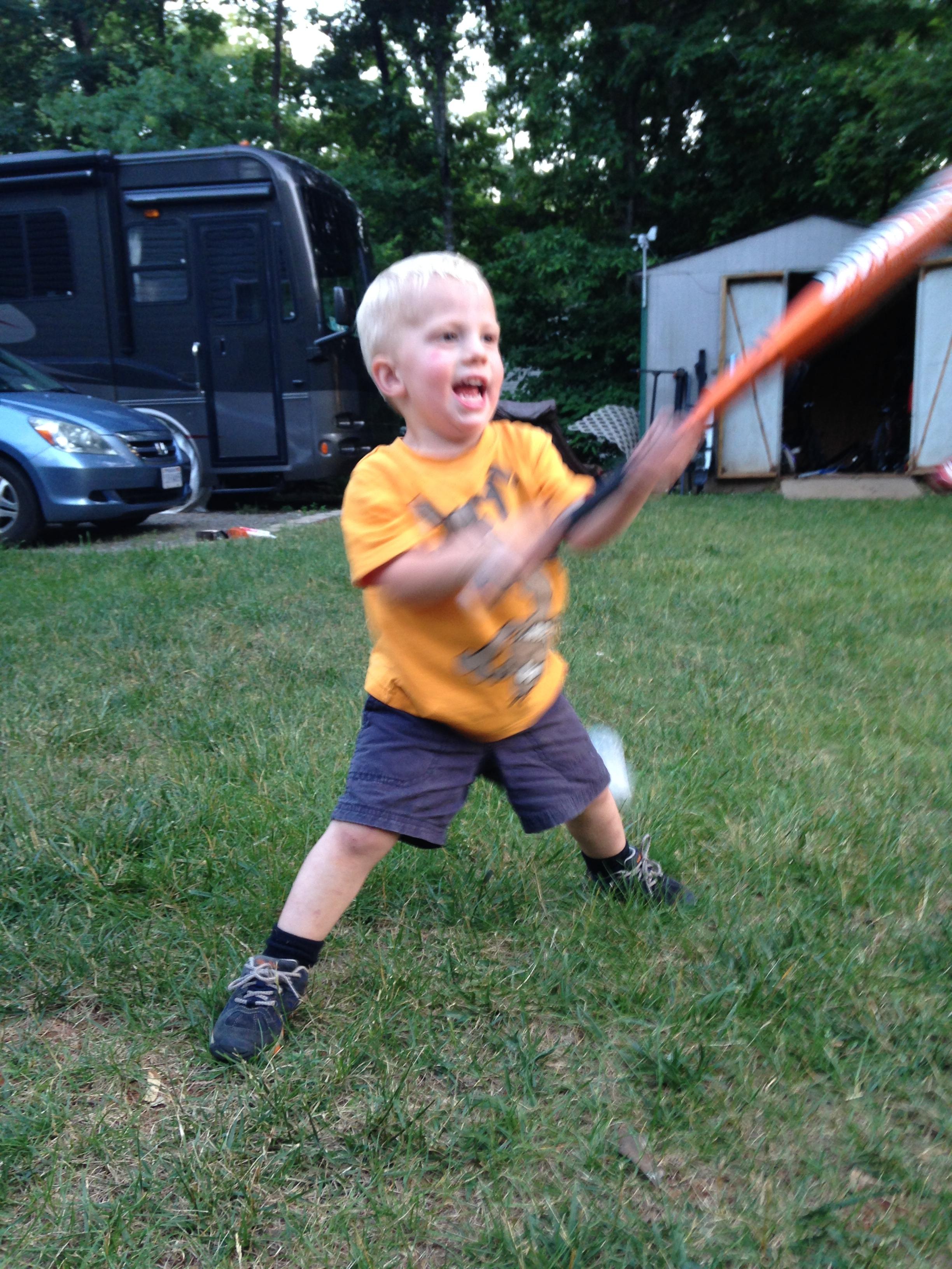 Kolby learning to play baseball.