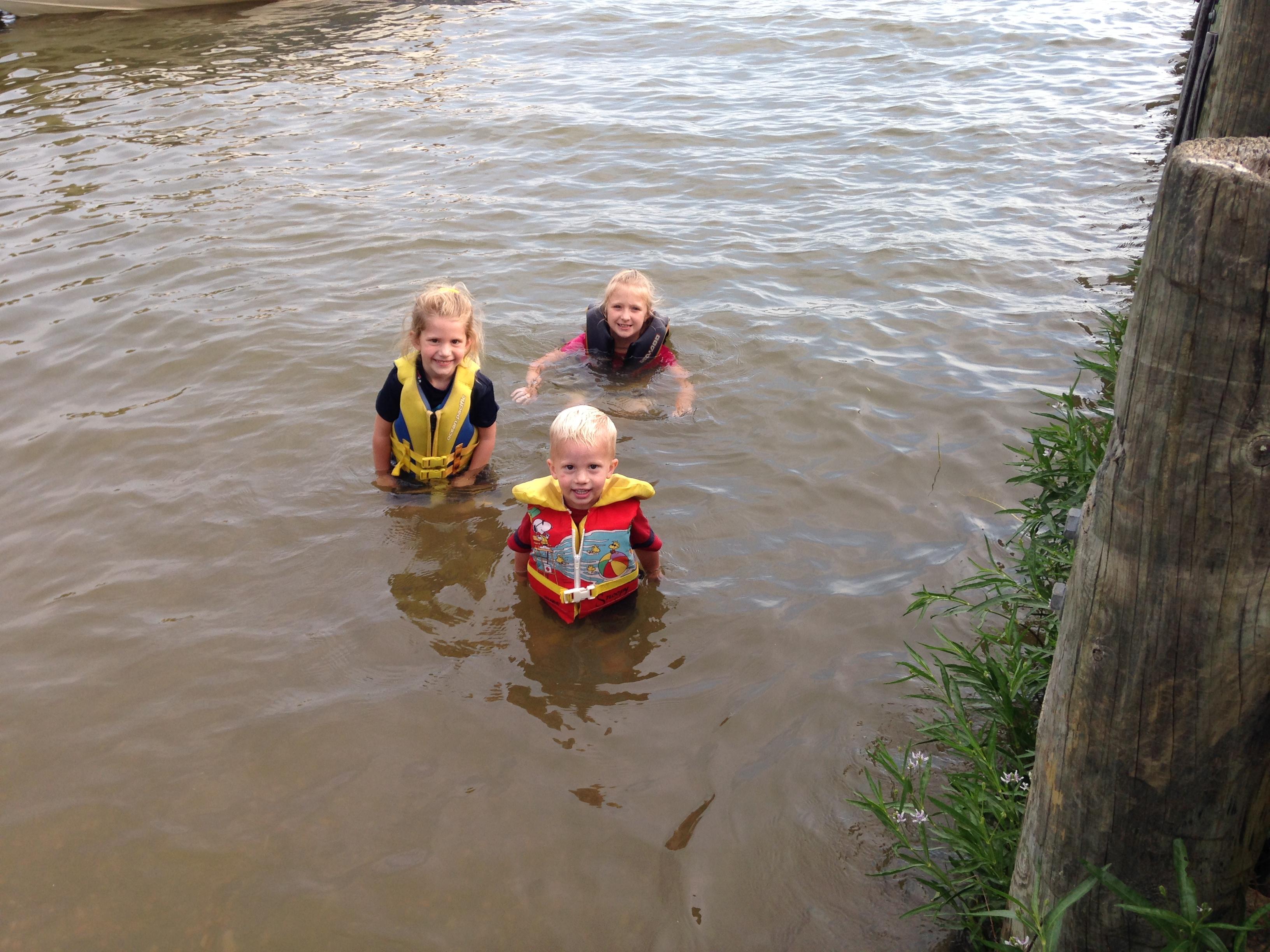 Swimming on the boat ramp. (Tara, Kaylin & Kolby)