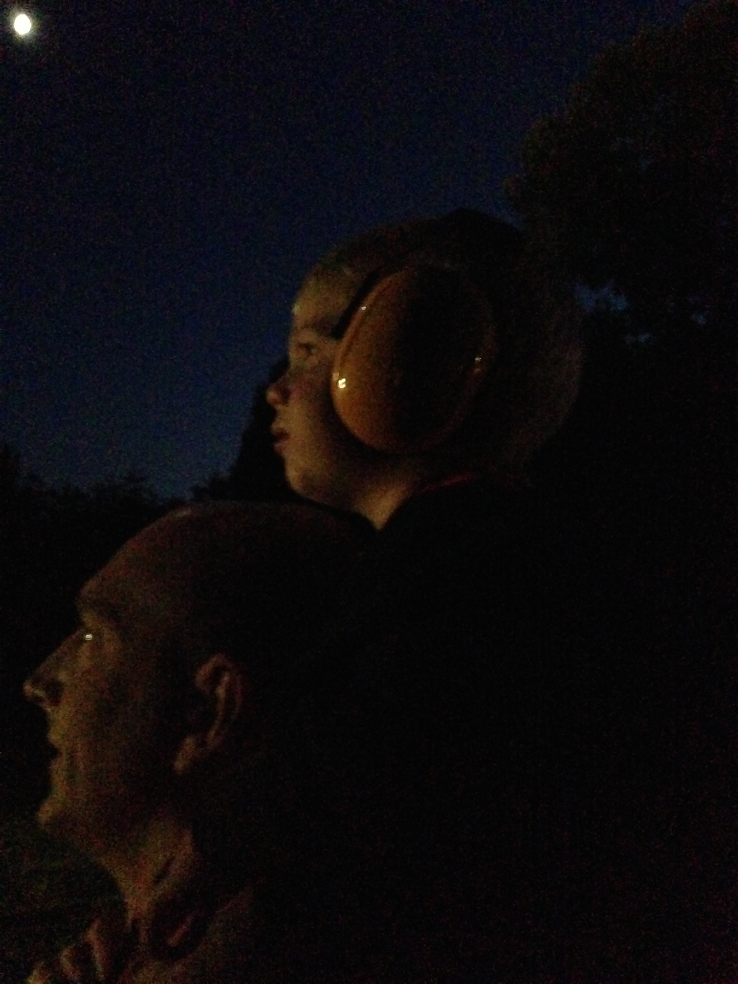 Kolby sat on Chester's shoulders watching fireworks with ear muffs on. He doesn't like loud noises.