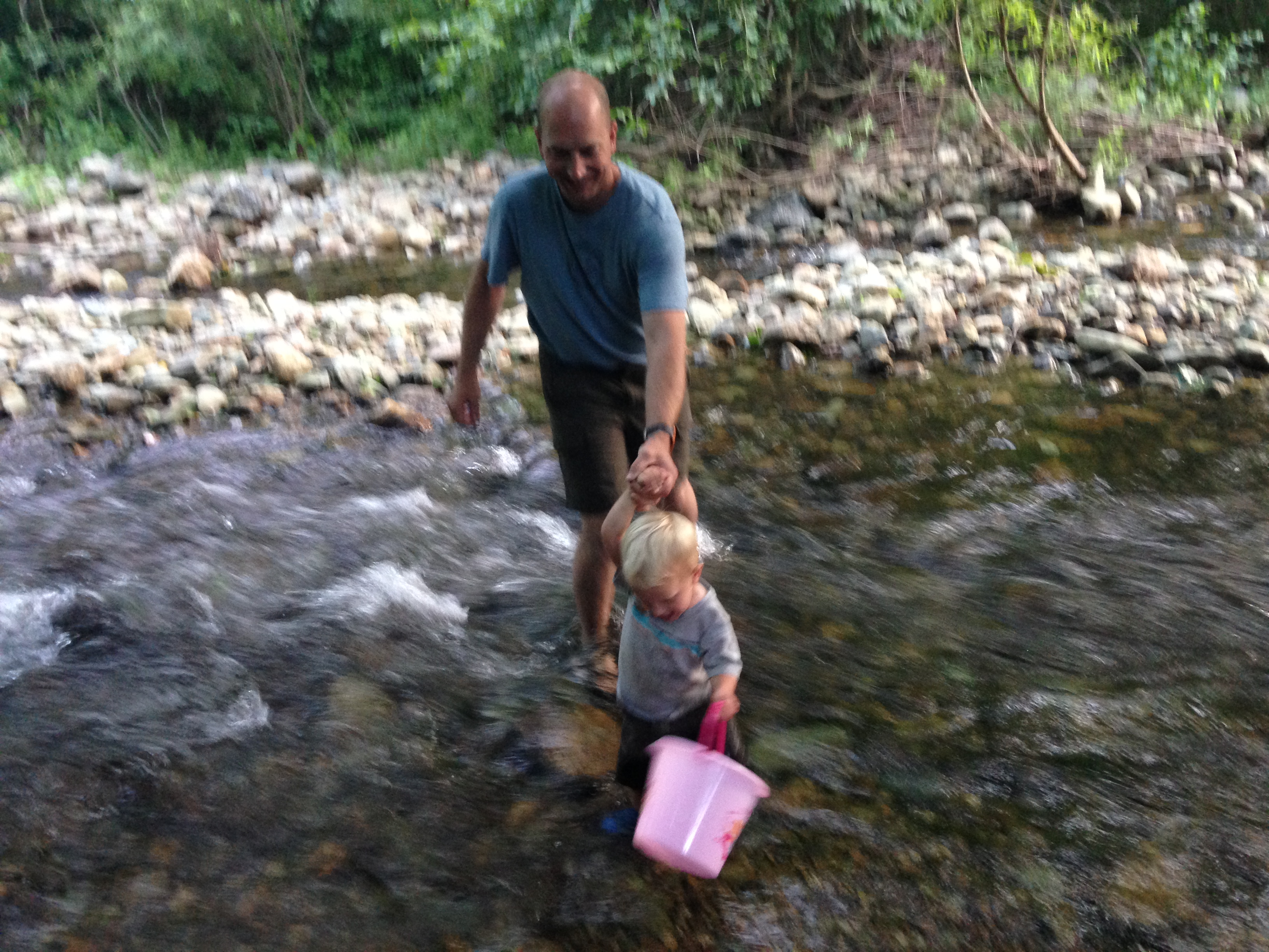 Ches trying to help Kolby not get washed downstream.