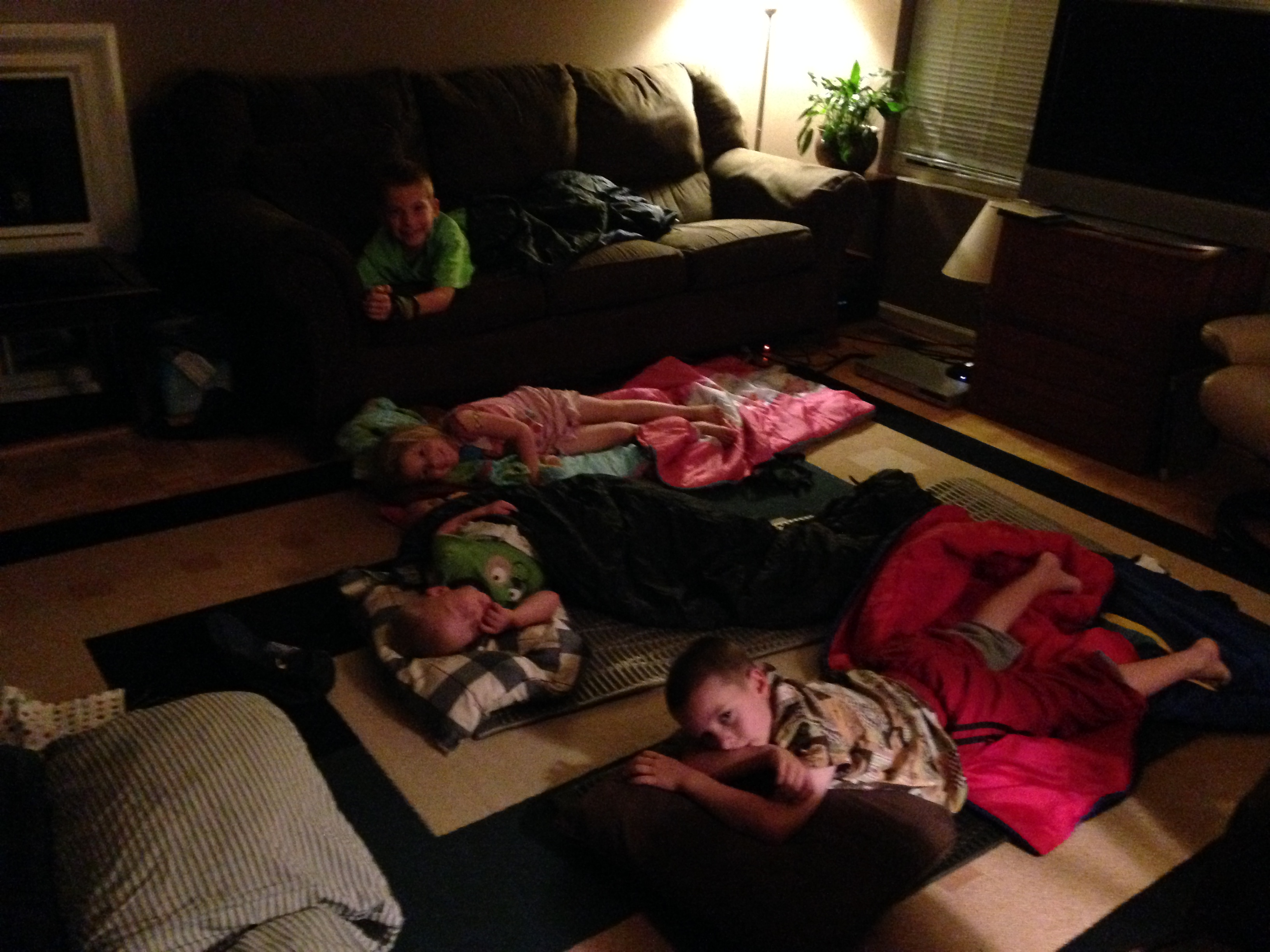 Family slumber party in the living room.