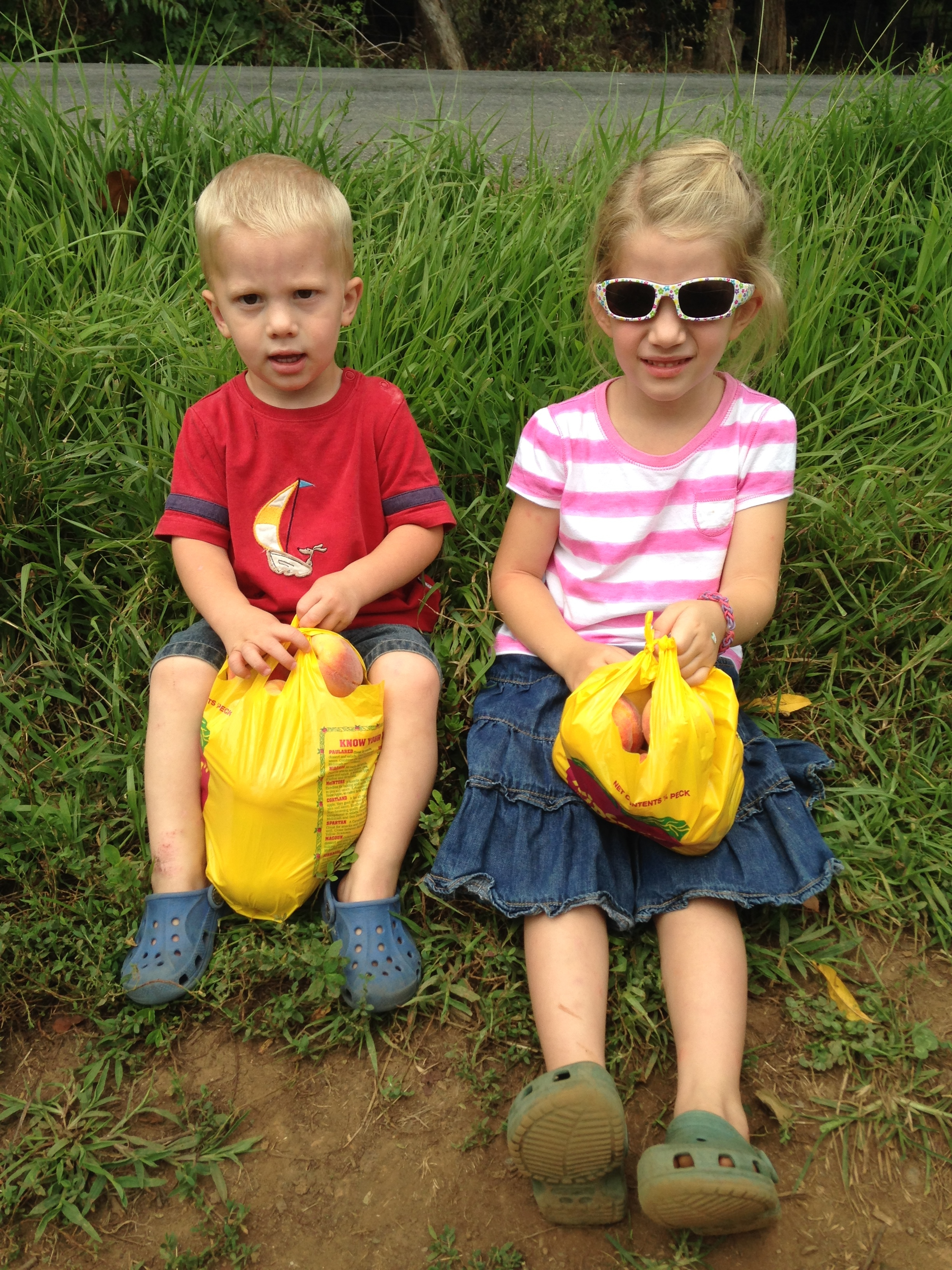 Kaylin & Kolby with their bags of peaches.