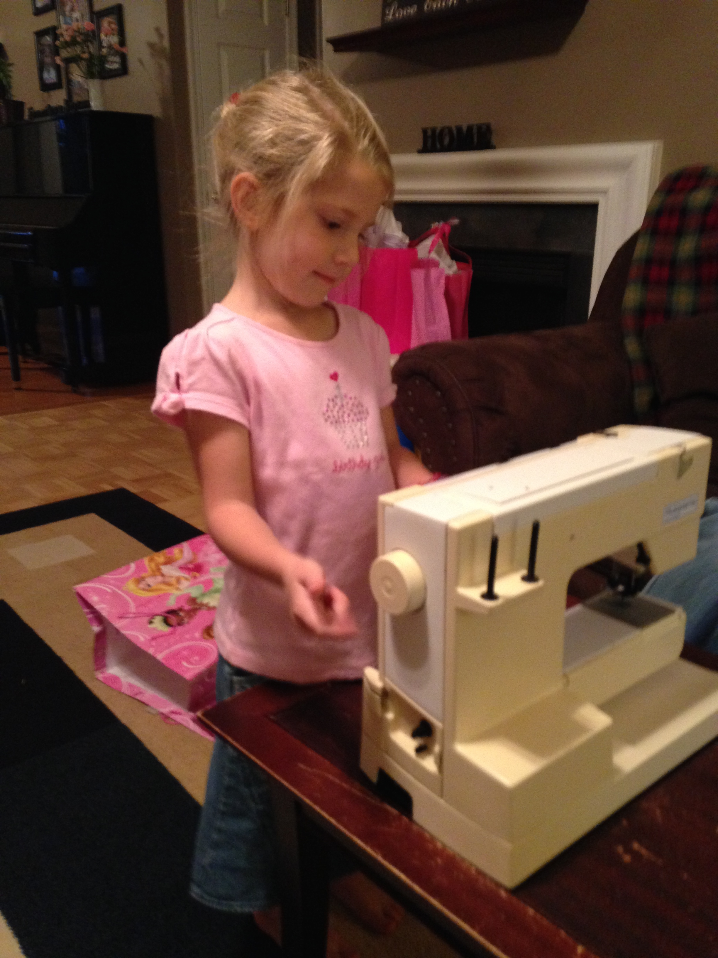 Checking out her new sewing machine from Daddy & Mama