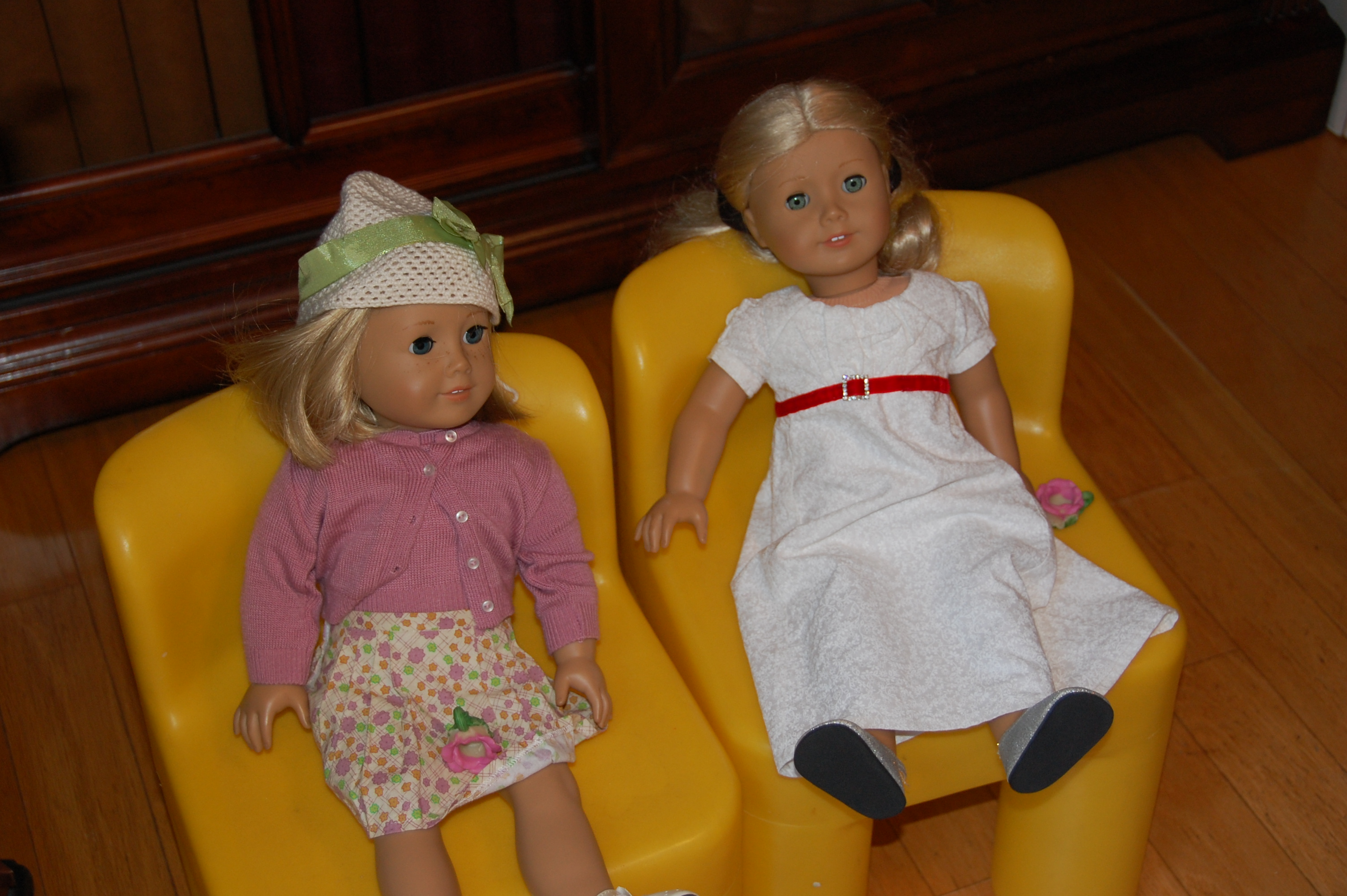 Two of the dolls waiting for their food.