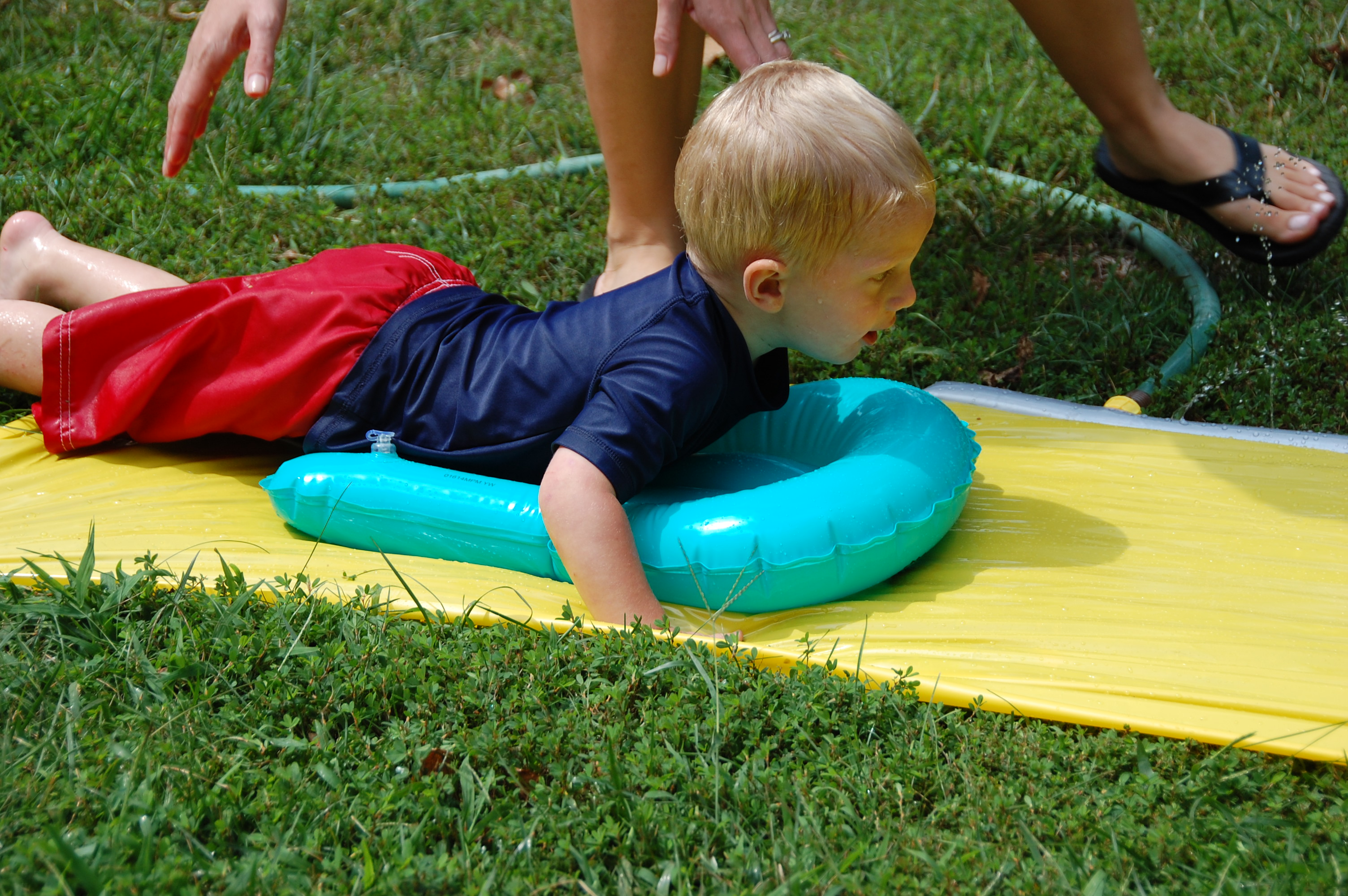 Kolby trying out the slip n slide.
