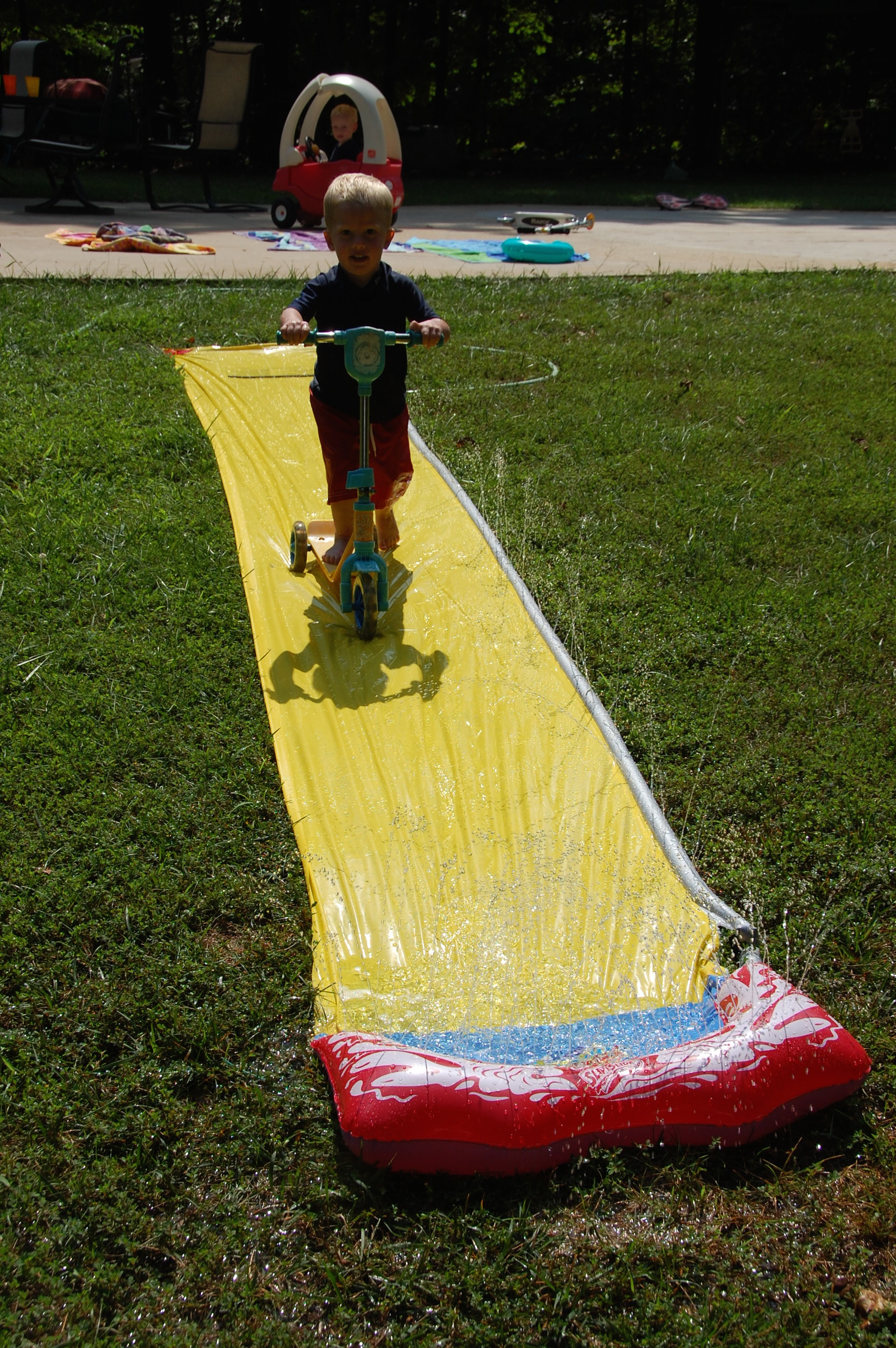 But Kolby on the other hand needed a little more excitement and started experimenting on ways to go down the slide.