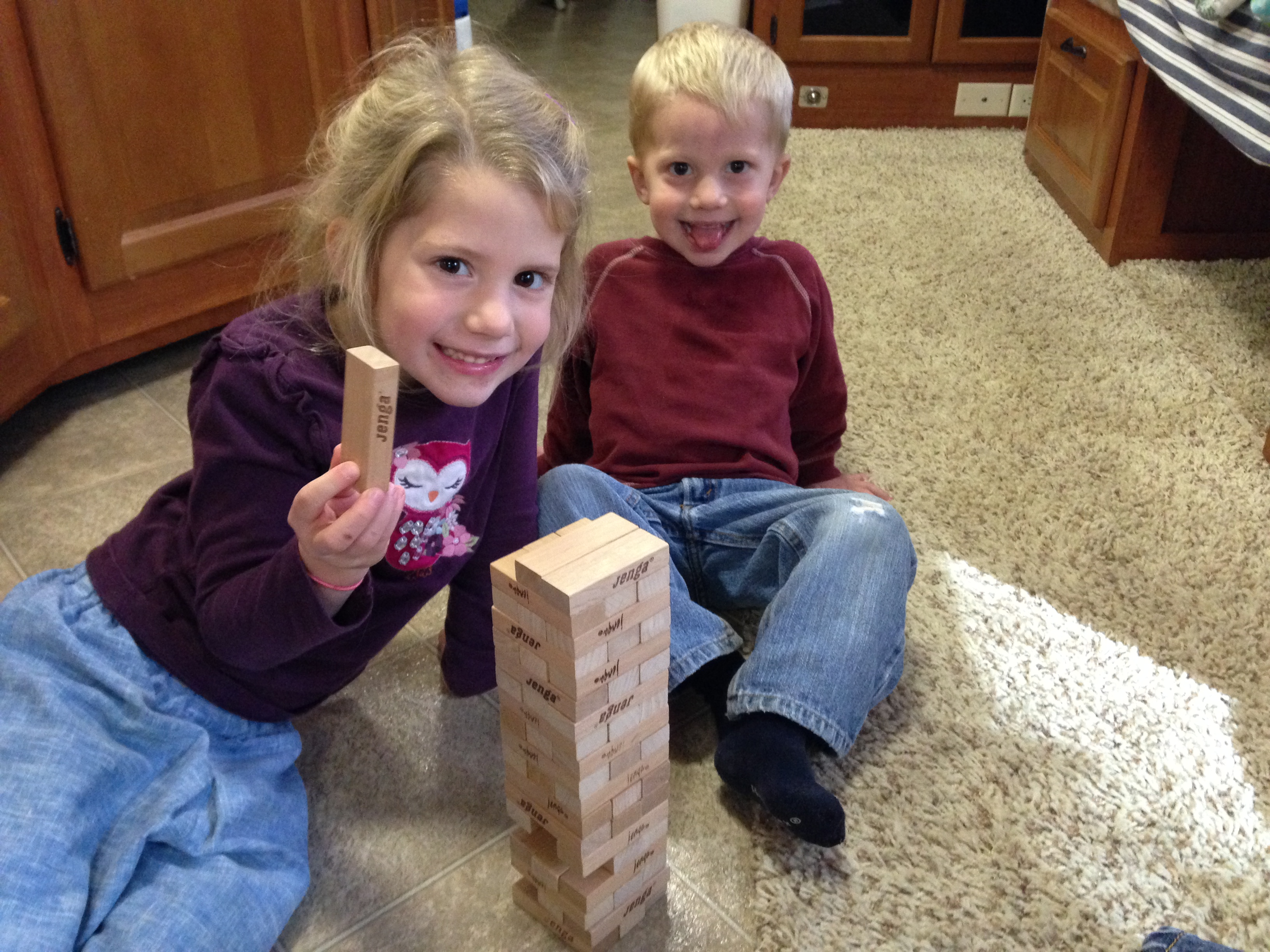 I got to pay Jenga with these 2 cute kids!