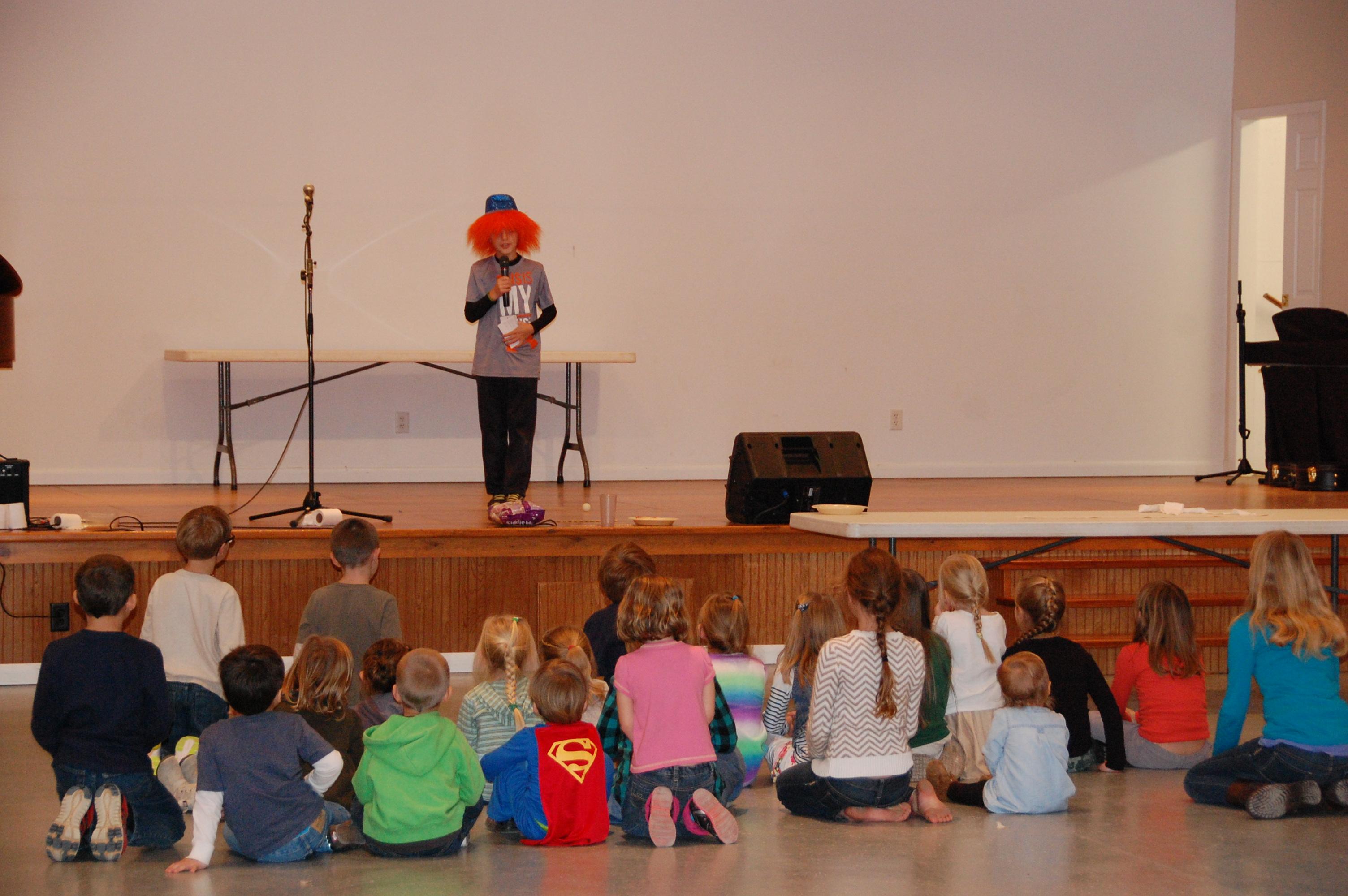 Brooks Cox telling jokes to the kids.