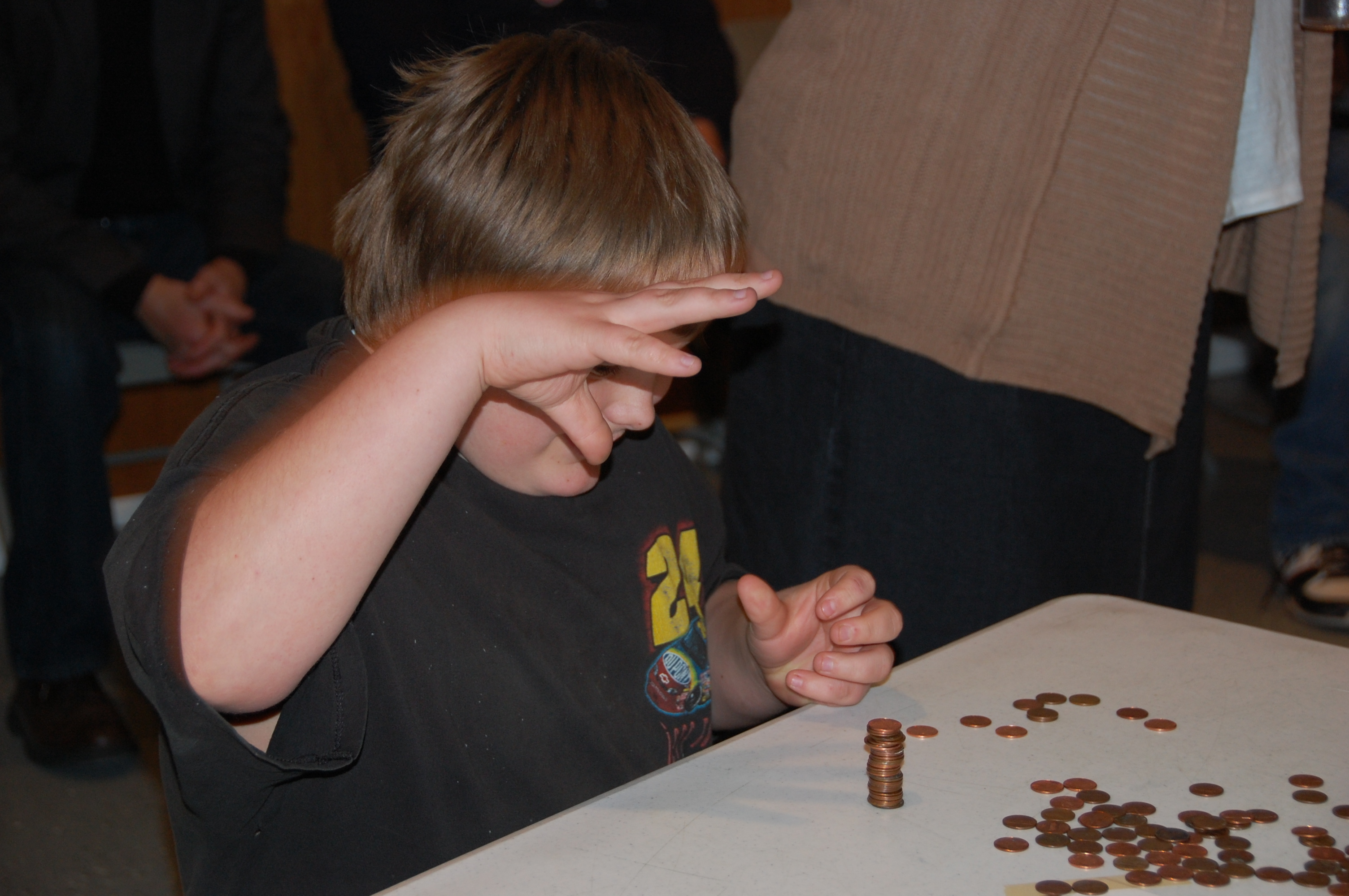 See how many pennies you can stack up in a certain amount of time.